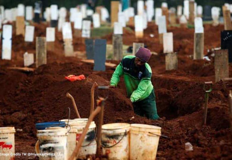 Indonesian guy digging graves